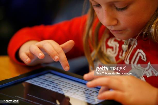 Anna Theis a third grader at Northpoint elementary school in Blaine worked on her ipad Thursday May 2, 2013 in Blaine , MN. ] JERRY HOLT •...