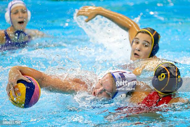 Anna Timofeeva of Russia and Judith Forca Ariza of Spain compete for the ball during their quarterfinal match at the Rio 2016 Olympic Games on August...