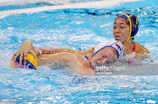 Anna Timofeeva of Russia battles Matilde Ortiz Reyes of Spain for the ball during the Women's Water Polo quarterfinal match at the Rio 2016 Olympic...