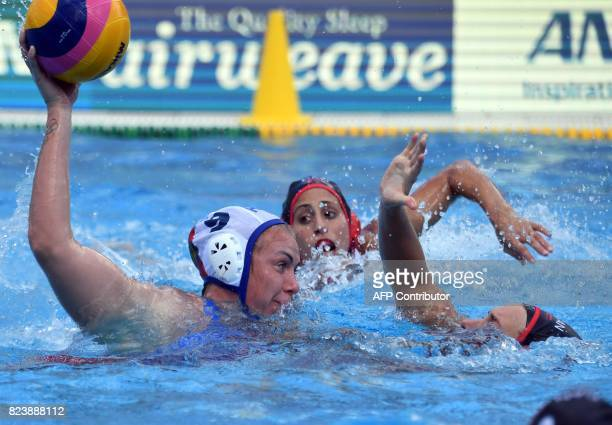 Anna Timofeeva of Russia scores a goal against Canadian Elyse LemayLavoie in 'Hajos Alfred' swimming pool in Budapest on July 28 2017 during the...