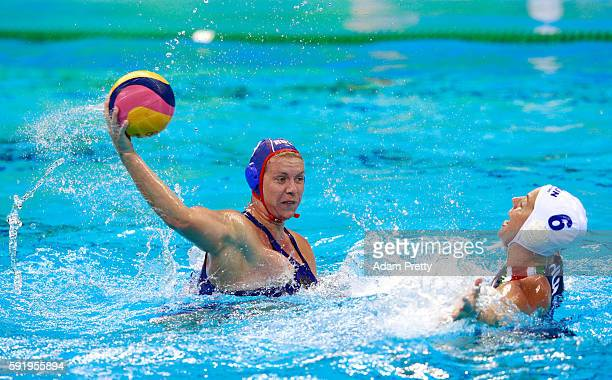 Anna Timofeeva of Russia shoots past Orsolya Takacs of Hungary during the Women's Water Polo Bronze Medal match between Hungary and Russia on Day 14...