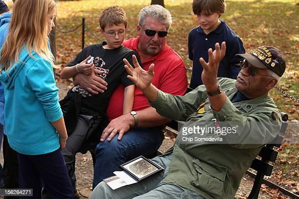 Anna Tollette 10 Nate Tollette 12 and Brian Jon Raichert 12 and their grandfather Bill Brandt of Antigo Wisconsin listen to Vietnam War veteran...