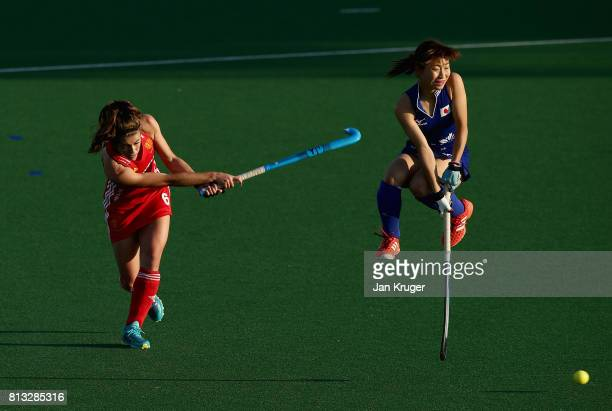 Anna Toman of England passes the ball under pressure from Yuri Nagai of Japan during day 3 of the FIH Hockey World League Semi Finals Pool A match...