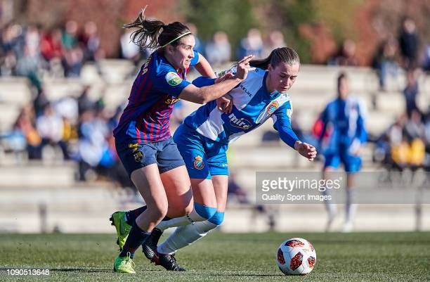 Anna Torroda of RCD Espanyol fights for the ball with Mariona Caldentey of FC Barcelona during the Iberdrola Women's First Division match between FC...