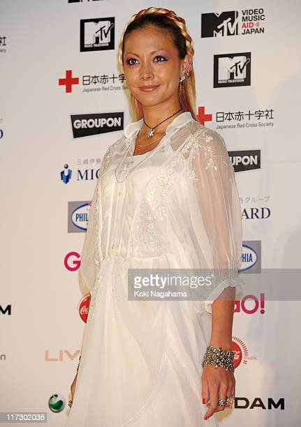 Anna Tsuchiya pose for photographs on the red carpet during the MTV Video Music Aid Japan at Makuhari Messe on June 25 2011 in Chiba Japan