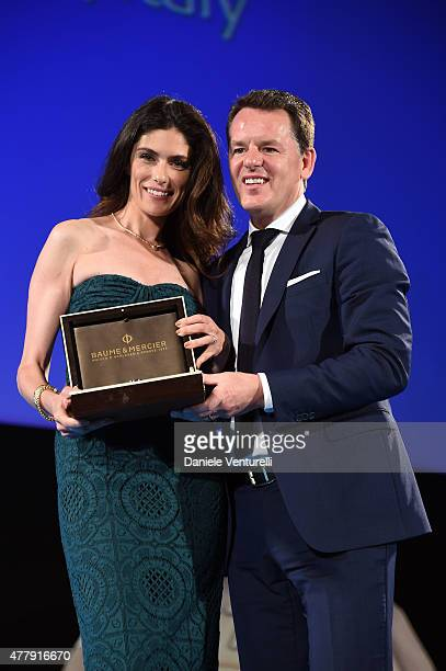 Anna Valle receives the Baume Mercier Award from Alain Zimmermann during Day 8 of the 61st Taormina Film Fest on June 20 2015 in Taormina Italy