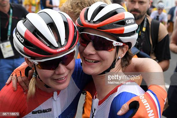 Anna van der Breggen celebrates with Marianne Vos of the Netherlands after winning the Women's Road Race on Day 2 of the Rio 2016 Olympic Games at...