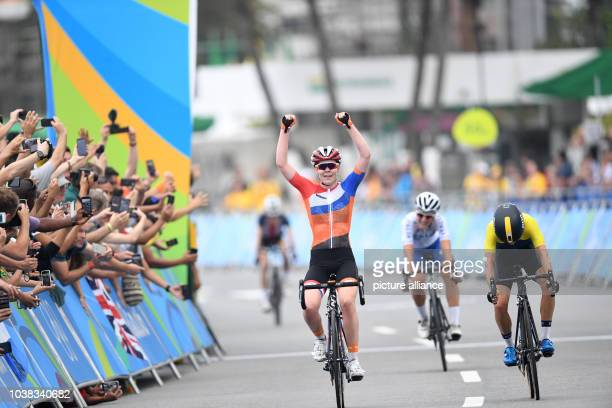 Anna van der Breggen from the Netherlands celebrates as she crosses the finish line to win the Gold medal at the Women's Road Race of the Cycling...