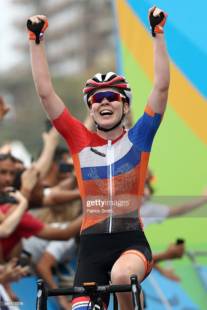 Anna van der Breggen of the Netherlands celebrates after winning the Women's Road Race on Day 2 of the Rio 2016 Olympic Games at Fort Copacabana on August 7, 2016 in Rio de Janeiro, Brazil.