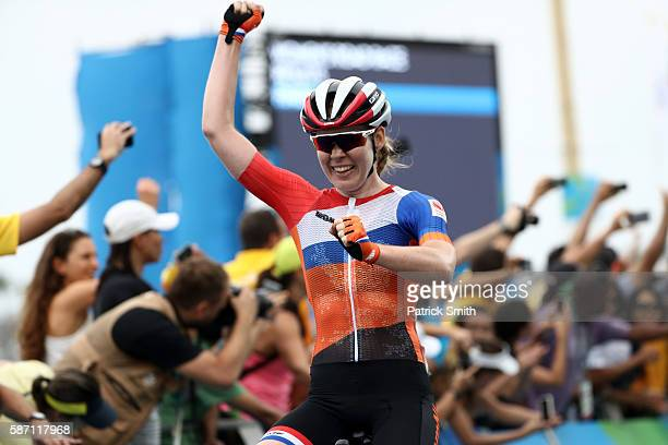 Anna van der Breggen of the Netherlands celebrates after winning the Women's Road Race on Day 2 of the Rio 2016 Olympic Games at Fort Copacabana on...