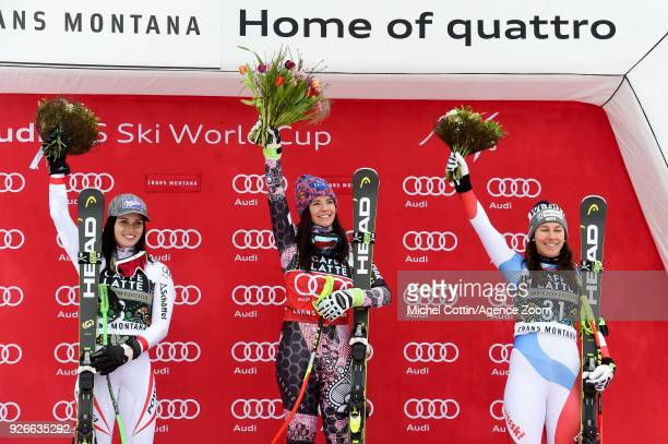 Anna Veith of Austria takes 2nd place Tina Weirather of Liechtenstein takes 1st place Wendy Holdener of Switzerland takes 3rd place during the Audi...