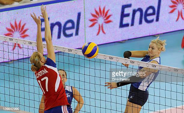 Anna Velikiy of Israel spikes the ball against Ivana Plchotova of Czech Republic during the Women's Volleyball European Championship match between...