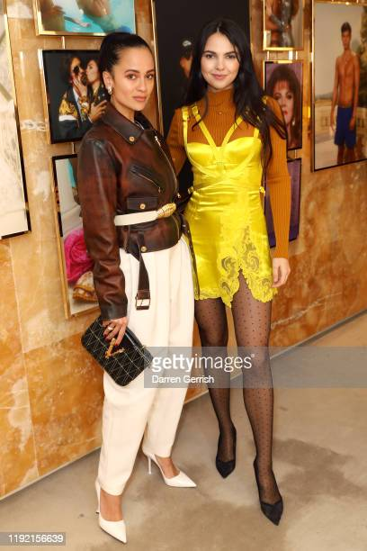 Anna Vitiello and Doina Ciobanu attend Versace holiday cocktail party on December 05, 2019 in London, England.