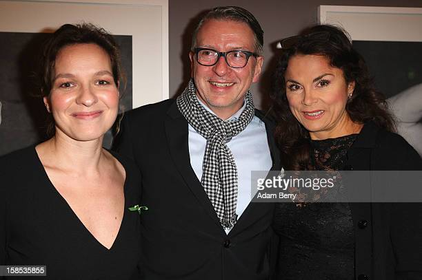 Anna von Griesheim her partner Andreas Marx and Mirjam Knickriem arrive for the opening of the Kampf Gegen Hunger exhibition on December 18 2012 in...