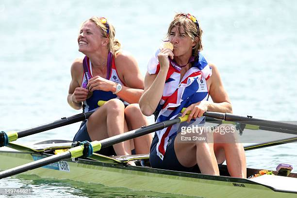 Anna Watkins and Katherine Grainger of Great Britain celebrate in their boat with their gold medals during the medal ceremony for the Women's Double...