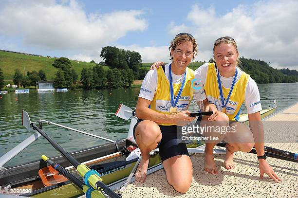 Anna Watkins and Katherine Grainger of Great Britain pose for the camera with their gold medals after winning the Wome's Double Sculls Final during...