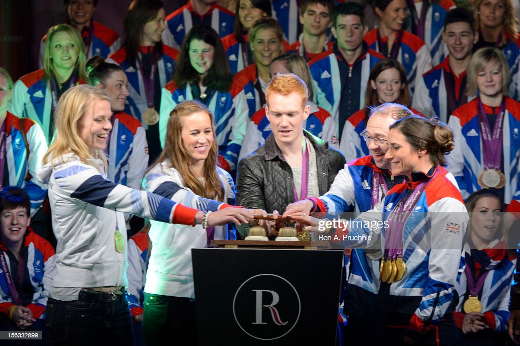 Anna Watkins, Helen Glover, Greg Rutherford, Barney Storey and Sarah Storey switch on the Regent Street Christmas Lights at Regent Street on November 13, 2012 in London, England.