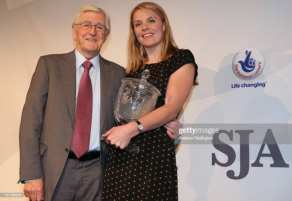 Anna Watkins of England receives the SJA Presidents Award from Sir Michael Parkinson during the SJA 2012 British Sports Awards at The Pavilion at the Tower of London on December 6, 2012 in London, England.