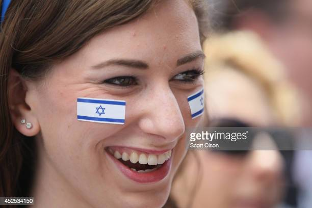 Anna Weinstein shows her support for Israel during a rally on July 22 2014 in Chicago Illinois More than 1000 people supporting both sides of the...