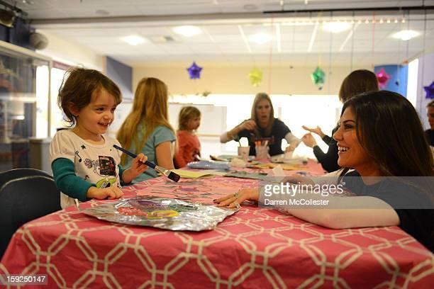 Anna Welker of the New England Patriots Women's Association visits Ava at Boston Children's Hospital on January 10 2013 in Boston Massachusetts