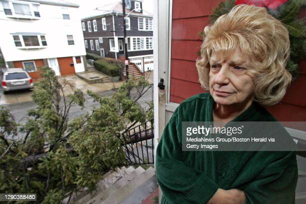 Anna Wesa, who is 75 and lived in her house for 52 years, looks out her front door at 16 Otis Street in Everett, at the tree that fell and blocked...