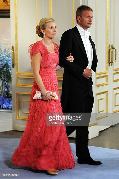 Anna Westling Blom sister of the groom and partner Mikael Soederstroem attend the wedding ceremony between Crown Princess Victoria of Sweden and...