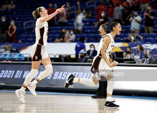 Anna Wilson and Lexie Hull of the Stanford Cardinal celebrate the win over the Louisville Cardinals during the Elite Eight round of the NCAA Women's...