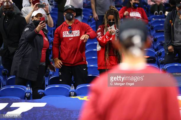 Anna Wilson of the Stanford Cardinal celebrates with her brother Russell Wilson of the Seattle Seahawks after the game against the Louisville...