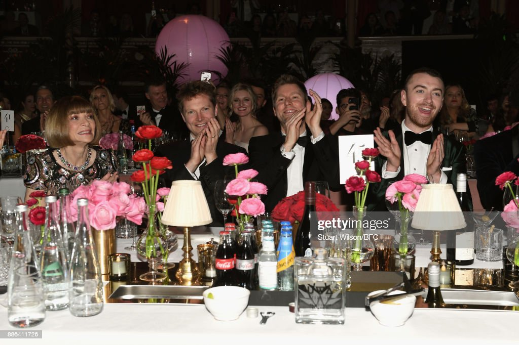 Anna Winour, a guest, Christopher Bailey MBE and Sam Smith during The Fashion Awards 2017 in partnership with Swarovski at Royal Albert Hall on December 4, 2017 in London, England.