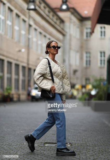 Anna Winter wearing Levis jeans, Prada bag and boots, Weekday jacket and Valentino shades on August 27, 2020 in Berlin, Germany.