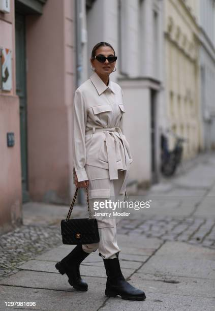 Anna Winter wearing Samsoe Samsoe two piece, Chanel bag and Copenhagen Studios boots during the Mercedes-Benz Fashion Week Berlin January 2021 on...