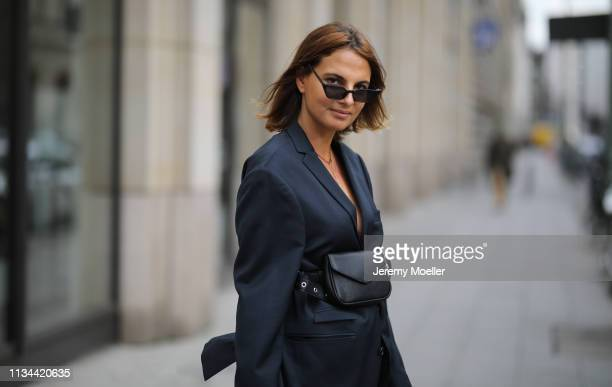 Anna Winter wearing Tiger of Sweden blazer and an EvenOdd bag on March 07 2019 in Berlin Germany