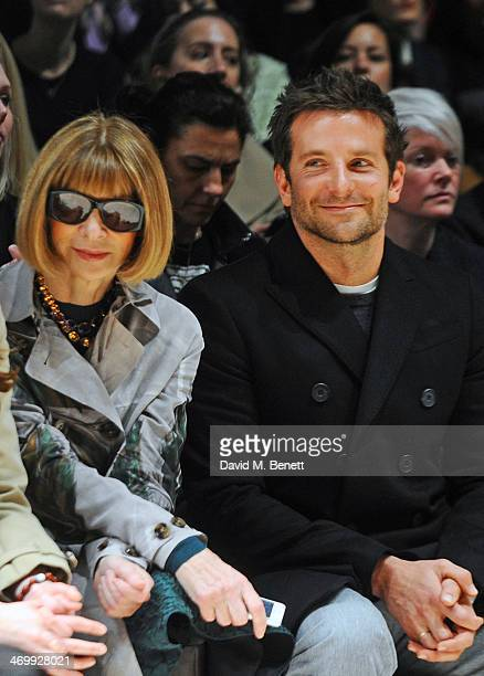 Anna Wintour and Bradley Cooper attend the front row at Burberry Womenswear Autumn/Winter 2014 at Kensington Gardens on February 17 2014 in London...