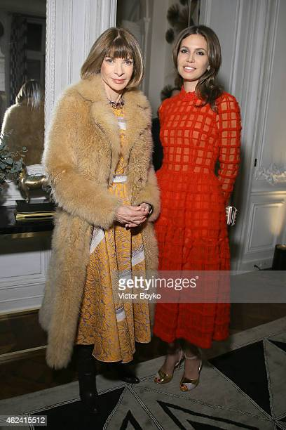 Anna Wintour and Dasha Zhukova attend the party for Dasha Zhukova' cover for Wall Street Journal on January 27 2015 in Paris France