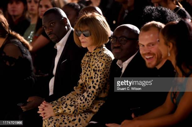 Anna Wintour and Edward Enninful watch from the front row during the Fashion For Relief catwalk show London 2019 at The British Museum on September...