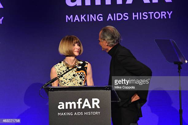 Anna Wintour and Patrick Demarchelier speak onstage at the 2015 amfAR New York Gala at Cipriani Wall Street on February 11, 2015 in New York City.