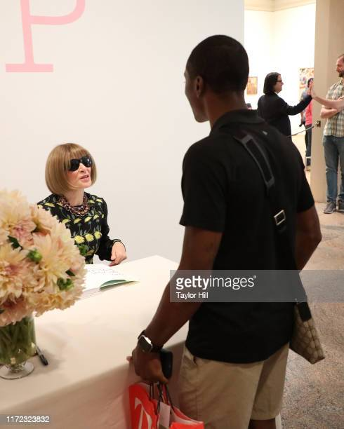 """Anna Wintour autographs copies of the """"Camp: Notes on Fashion"""" exhibition catalogue at Metropolitan Museum of Art on September 04, 2019 in New York..."""