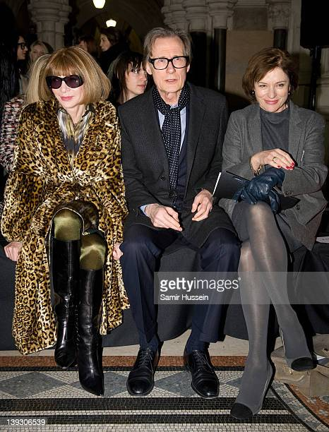 Anna Wintour Bill Nighy and Diana Quick attend the Nicole Farhi show during London Fashion Week Autumn/Winter 2012 at the Royal Courts of Justice on...