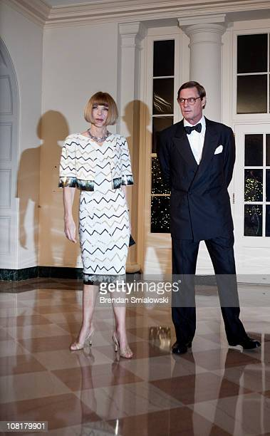Anna Wintour editorinchief of American Vogue magazine and Shelby Bryan arrive at the White House for a state dinner 19 2011 in Washington DC...