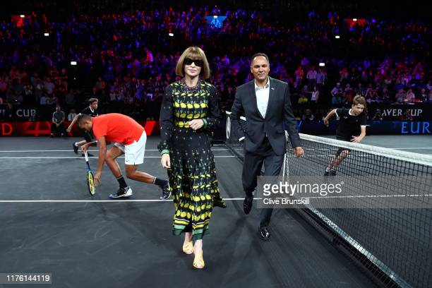 Anna Wintour, Editor-in-chief of Vogue and Artistic Director of Conde Nast walks off the court after performing the coin toss ahead of the singles...