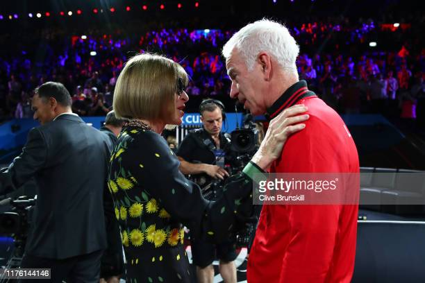 Anna Wintour, Editor-in-chief of Vogue and Artistic Director of Conde Nast speaks with John McEnroe, Captain of Team World after performing the coin...