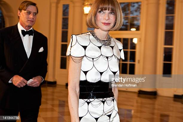 Anna Wintour editorinchief of Vogue magazine arrives with Shelby Bryan for a State Dinner in honor of British Prime Minister David Cameron at the...