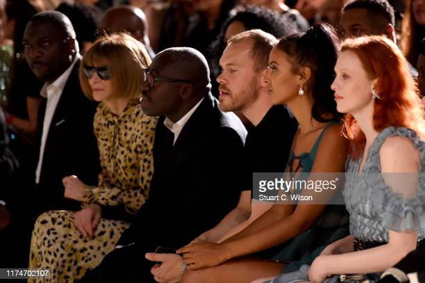 Anna Wintour Edward Enninful Maya Jama and Karen Elson watch from the front row during the Fashion For Relief catwalk show London 2019 at The British...