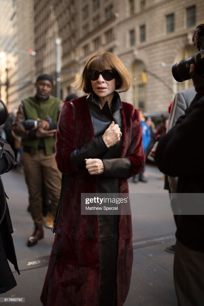 Anna Wintour is seen on the street attending OSCAR DE LA RENTA during New York Fashion Week wearing a long burgundy coat with black outfit on February 12, 2018 in New York City.