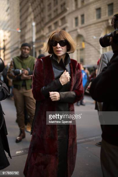 Anna Wintour is seen on the street attending OSCAR DE LA RENTA during New York Fashion Week wearing a long burgundy coat with black outfit on...