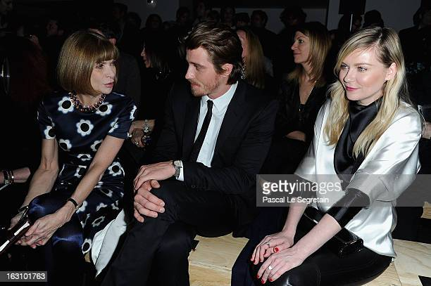 Anna Wintour Kirsten Dunst and Garrett Hedlund attend the Saint Laurent Fall/Winter 2013 ReadytoWear show as part of Paris Fashion Week on March 4...