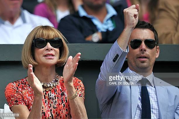 Anna Wintour US Vogue editor in chief applauds as German player Sabine Lisicki plays with Russian player Maria Sharapova during the women's semi...