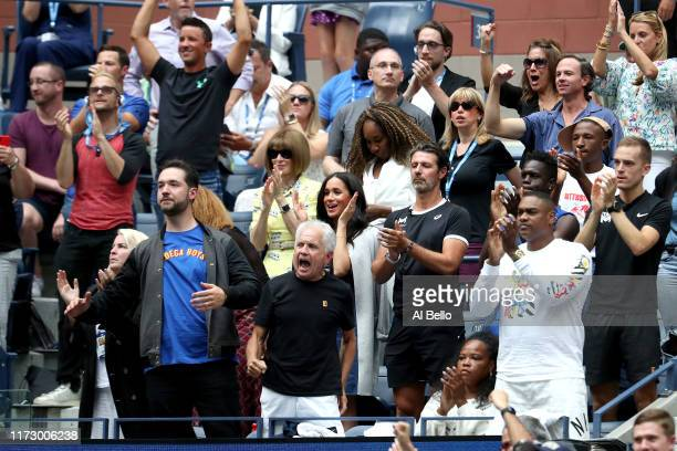 Anna Wintour Venus Williams coach Patrick Mouratoglou Alexis Ohanian and Meghan Duchess of Sussex cheer for Serena Williams of the United States...