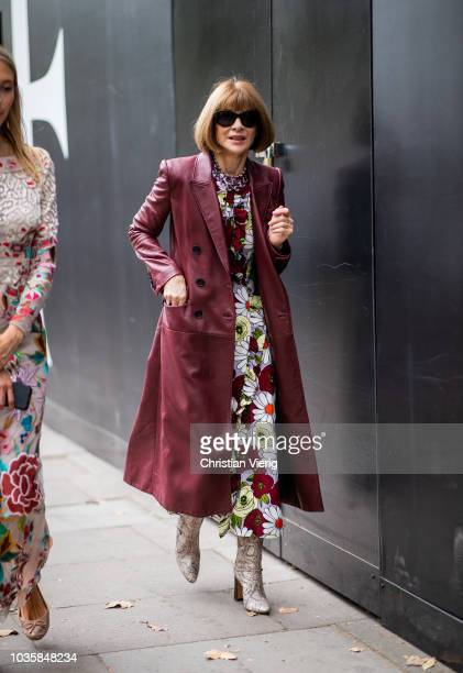 Anna Wintour wearing bordeaux leather coat dress with floral print boots is seen outside Richard Quinn during London Fashion Week September 2018 on...