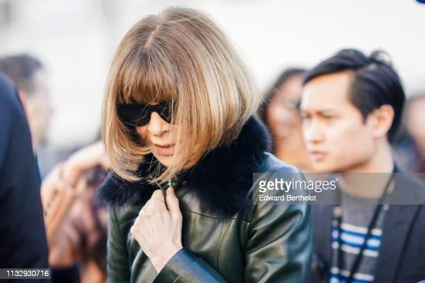 Anna Wintour wears a green leather coat outside Chloe during Paris Fashion Week Womenswear Fall/Winter 2019/2020 on February 28 2019 in Paris France